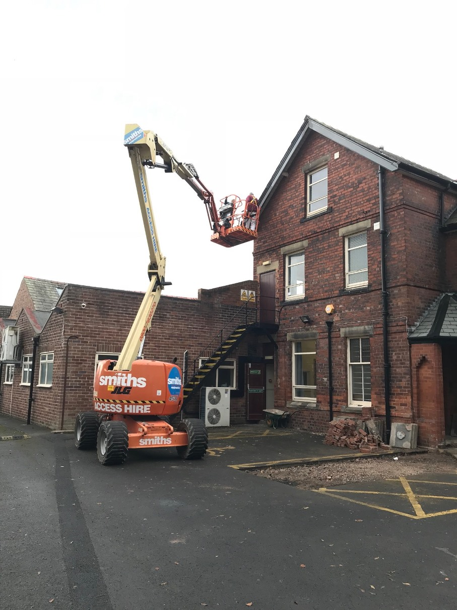 Cherry Picker inspecting the roof